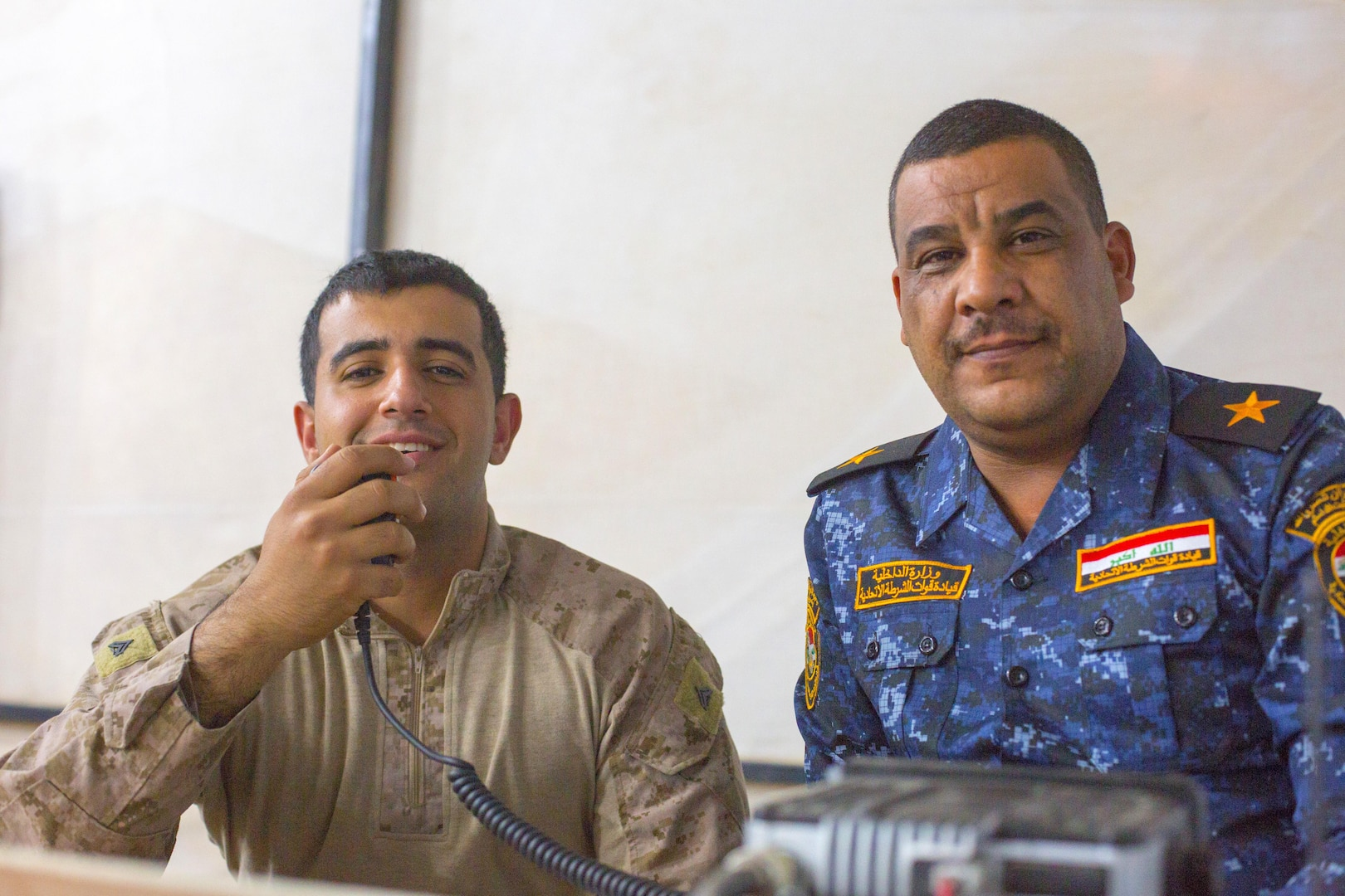 U.S. Marine Corps Cpl. Ali Mohammed, left, a member of the 3rd Battalion, 7th Marine Regiment, Special Purpose Marine Ground Air Task Force – Crisis Response – Central Command advise and assist team, poses for a photo with a member of the Iraqi security forces his team advises, Oct. 23, 2016, at Qayyarah West Airfield, Iraq. The Marines, alongside Soldiers from the 1st Squadron, 75th Regiment of the U.S Army's 101st Airborne Division (Air Assault), are aiding the ISF as they retake territory from Islamic State of Iraq and the Levant. (U.S. Army photo by Spc. Christopher Brecht)