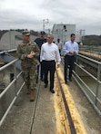 Colonel Secrist met with Congressman Brad Wenstrup at the Meldahl Lock and Dam for a project tour.  He briefed the congressman on how integration with the hydropower plant works, the USACE navigation mission, the completed work of the auxiliary lock chamber gates, as well as an explanation of the planned main lock chamber gate replacement in the summer of 2017.