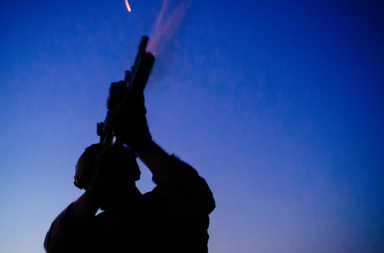 U.S. Air Force Staff Sgt. Steven Armbright, 821st Contingency Response Group first in security team member, fires a flare from a defensive fighting position while on perimeter watch at Qayyarah West Airfield, Iraq, Nov. 17, 2016. The 821st CRG is highly-specialized in training and rapidly deploying personnel to quickly open airfields and establish, expand, sustain and coordinate air mobility operations in austere, bare-base conditions. (U.S. Air Force photo by Senior Airman Jordan Castelan)