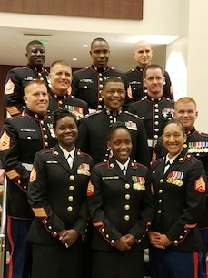 Station commanders across Recruiting Station Montgomery gather together for a photo with Maj. Dwane Sims Oct. 29, 2016, during the 241st Marine Corps Birthday Ball celebration at the Renaissance Montgomery Hotel and Spa in Montgomery, Alabama. Sims is the acting Commanding Officer for Recruiting Station Montgomery. (Official Marine Corps courtesy photo/Released)