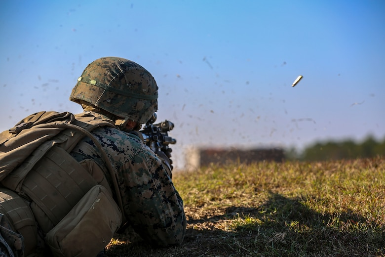Lance Cpl. William Finn fires an M4 Carbine rifle during a training exercise at Camp Lejeune, N.C., Nov 16, 2016. The Marines practiced squad-sized movements in order to maintain unit readiness for their upcoming Integrated Training Exercise at the Marine Corps Air Ground Combat Training Center in Twentynine Palms, California. Finn is a grenadier with 1st Battalion, 8th Marine Regiment.  (U.S. Marine Corps Photo by Lance Cpl. Jon Sosner)
