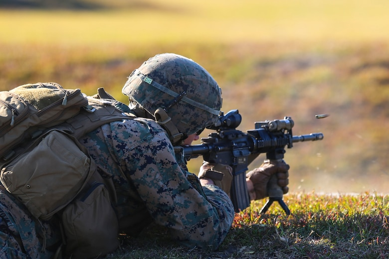 Lance Cpl. Derek Perez-Pantoja fires an M4 Carbine rifle during a training exercise at Camp Lejeune, N.C., Nov 16, 2016. The Marines practiced squad-sized movements in order to maintain unit readiness for their upcoming Integrated Training Exercise at the Marine Corps Air Ground Combat Training Center in Twentynine Palms, California. Perez-Pantoja is a rifleman with 1st Battalion, 8th Marine Regiment.  (U.S. Marine Corps Photo by Lance Cpl. Jon Sosner)