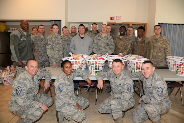 First sergeants and volunteers stand behind their Thanksgiving baskets in the High Plains chapel at F. E. Warren Air Force Base, Wyo., Nov. 18, 2016.  More than 20 90th Missile Wing Airmen came together to assemble 125 baskets equipped with everything needed to provide a complete meal, including a gift card to purchase a turkey. The baskets will be delivered to junior-ranking Airmen, selected by their chain of command, to ensure their families are able to enjoy a Thanksgiving meal for the holiday. (U.S. Photo by 2d Lt. Nikita Thorpe)