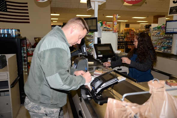 Master Sgt. Brandon Finefrock, 90th Missile Security Forces Squadron first sergeant, purchases commissary food items to assemble 125 Thanksgiving baskets at F.E. Warren Air Force Base, Wyo., Nov. 18, 2016.  Also known as OPERATION WARMHEART to the public, many of the funds are provided through community members and the Combined Federal Campaign charity (code 19015). The baskets will be delivered to junior-ranking Airmen, selected by their chain of command, to ensure their families are able to enjoy a Thanksgiving meal for the holiday. (U.S. Photo by 2d Lt. Nikita Thorpe)