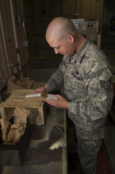 Staff Sgt. Bryan Thompson, 90th Munition Squadron munitions operations NCO in charge, performs inventory of 9mm ammunition at F.E. Warren Air Force Base, Wyo., Oct. 31, 2016. The 90th MUNS is responsible for the inventory and tracking of more than 7 million munitions. The 90th MUNS mission is to enable nuclear deterrence by maintaining combat ready munitions in defense of global freedoms safely, securely and effectively. (U.S. Air Force photo by Staff Sgt. Christopher Ruano)