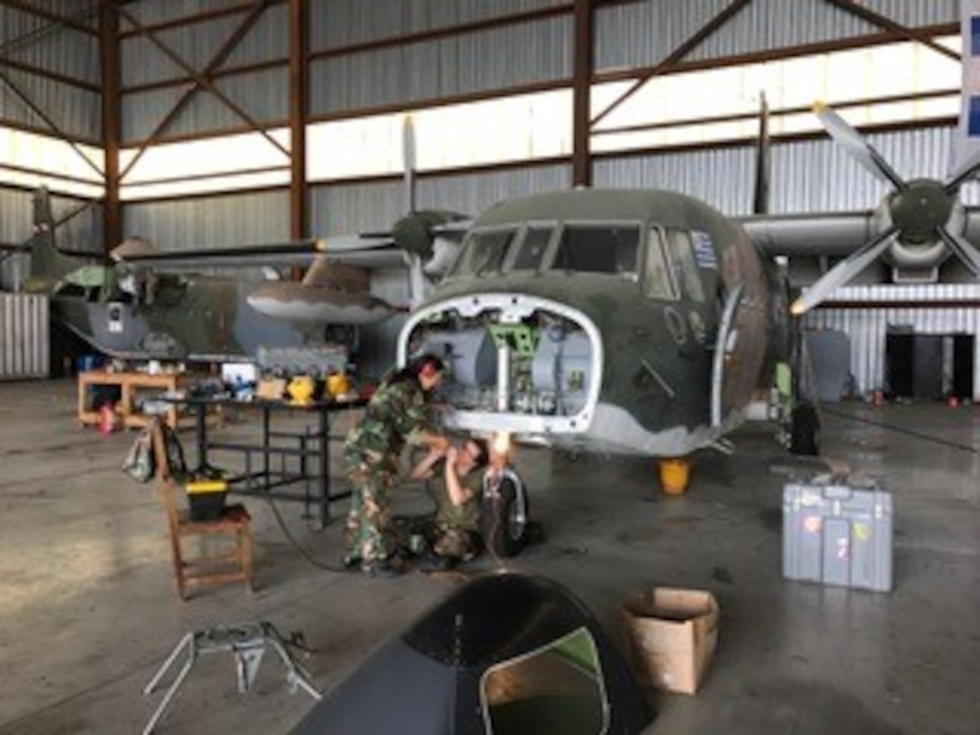 Military members assigned to Twelfth Air Force (Air Forces Southern) participated in a C-130 and rotary maintenance and supply management subject matter expert exchange with the Uruguayan Air Force in Montevideo, Uruguay from Nov. 7-10, 2016.  During the exchange, the team met with FAU leadership and visited various fixed wing and rotary wing maintenance and supply management sections. Exchanges like this are conducted regularly throughout the year and involve U.S. Airmen sharing best practices and procedures to build partnerships and promote interoperability with partner-nation air forces throughout South America, Central America and the Caribbean. (Courtesy Photo)
