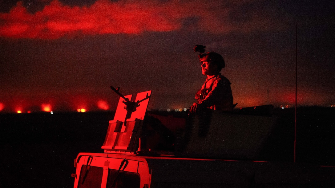 Senior Airman Johnathan Sorber, 821st Contingency Response Group first in security team member, scans the horizon while traveling to a defensive fighting position while on perimeter watch at Qayyarah West Airfield, Iraq, Nov. 17, 2016. The 821st CRG is highly-specialized in training and rapidly deploying personnel to quickly open airfields and establish, expand, sustain and coordinate air mobility operations in austere, bare-base conditions. (U.S. Air Force photo by Senior Airman Jordan Castelan)