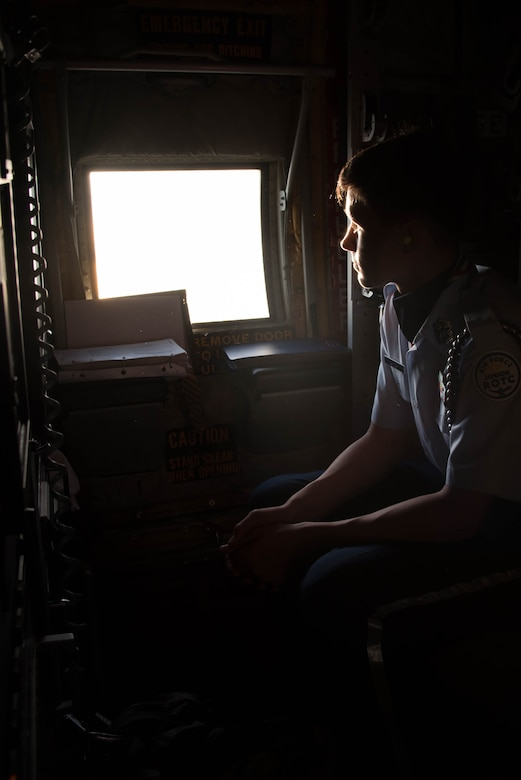 A student from the Biloxi High School JROTC team looks out the window of a WC-130J Super Herculese Aircraft. His team won the Biloxi High School JROTC team won the Mississippi All Services JRTOC Drill Competition Nov. 18 at Keesler Air Force Base, Miss. and had a chance to fly with the 53rd Weather Reconnaissance Squadron Hurricane Hunters to learn more about the mission of the Air Force Reserve. (U.S. Air Force photo/Staff Sgt. Heather Heiney)