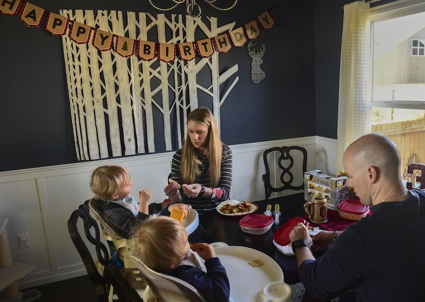 Mandy and Capt. Matthew Douglas feed their children Nov. 3, 2016, in Colorado Springs, Colo. The twins, born premature at 23 weeks, 17 weeks earlier than normal, celebrated their third birthday with family Nov. 2. Being able to feed the children together is a rarity due to Matthew Douglas' position as a logistical and support officer for Air Force Space Command. (U.S. Air Force photo by Airman 1st Class Gabrielle Spradling/Released)