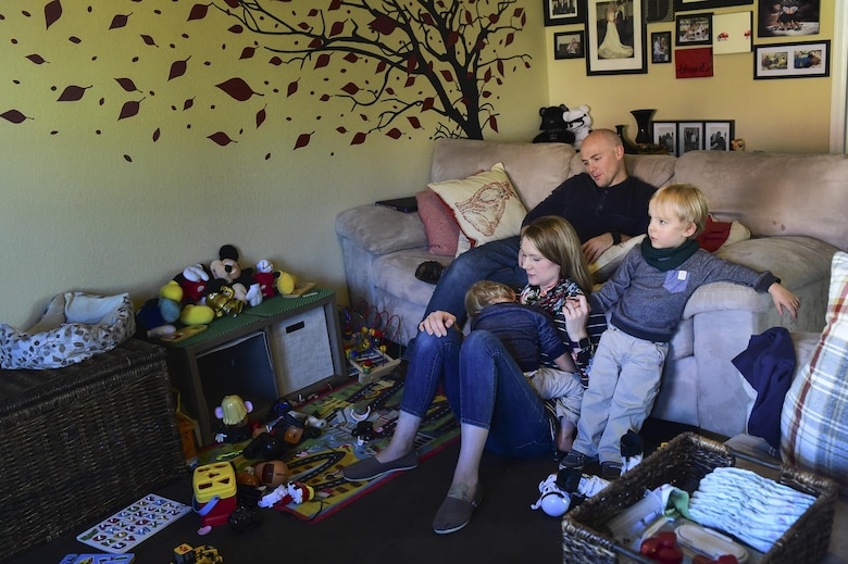 The Douglas family sits together Nov. 3, 2016, at their home in Colorado Springs, Colo. The parents not only tackle everyday tasks, such as keeping a clean house and working, but they also take care of their twin boys who suffer from many medical issues due to a complicated, premature birth. (U.S. Air Force photo by Airman 1st Class Gabrielle Spradling/Released)