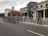 Airmen from Air University at Maxwell Air Force Base march in a Veterans Day parade Nov. 11, 2016 in downtown Montgomery, Ala. The parade was co sponsored by the Montgomery Area Chamber of Commerce and the American Legion Department of Alabama. (U.S. Air Force photo/Lt. Col. Mae-Li Allison