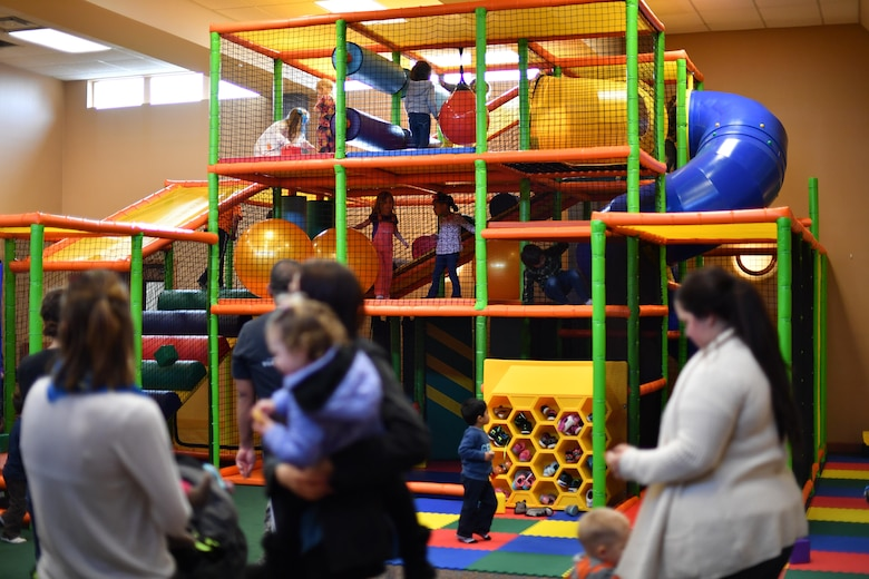 Children and spouses enjoy the newly installed amenities of the Community Activites Center during its reopening on Grand Forks Air Force Base, N.D., Nov. 21, 2016. The facility remodel cost an estimated $300,000, and the project was completed within 16 months. (U.S. Air Force photo by Airman 1st Class Elijaih Tiggs)