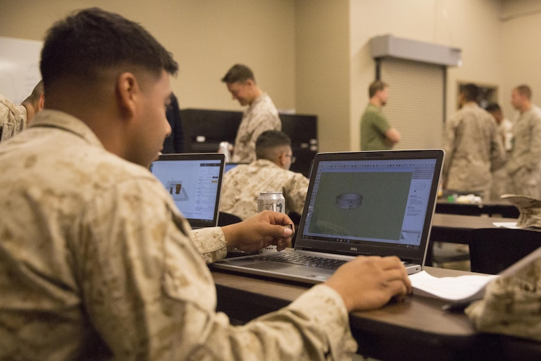 A Marine with 1st Battalion, 7th Marine Regiment, constructs an object using 3D printing technology during a 3D printing class aboard Marine Corps Air Ground Combat Center, Twentynine Palms, Calif., Nov. 16, 2016. Over the three-day course, Marines were challenged to manufacture innovative solutions for the problems presented to them using 3D printing innovation. (Official Marine Corps photo by Cpl. Medina Ayala-Lo/Released)