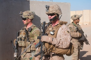 Army 1st Lt. Patrick Abele, left, 1st Squadron, 75th Cavalry Regiment, Task Force Strike, and Marine Corps Master Sgt. Travis Madden, Special Purpose Marine Air Ground Task Force - Crisis Response - Central Command, monitor the status of a joint readiness drill at Qayyarah West Airfield, Iraq, Nov. 17, 2016. Army photo by 1st Lt. Daniel Johnson