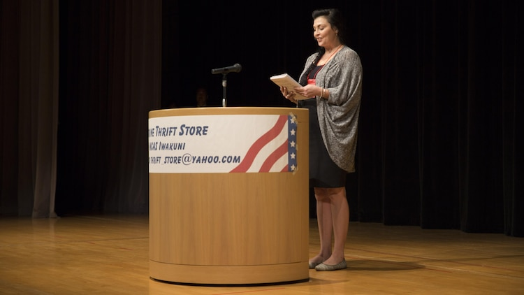 Julie Pace, a speech contestant, presents a speech at the 55th Annual Japanese and English Speech Contest at the Iwakuni Sinfonia in Iwakuni City, Japan, Nov. 13, 2016. Speech contestants were judged on their articulation, enunciation, and clear and concise speaking as well as their overall performance. (U.S. Marine Corps photo by Pfc. Gabriela Garcia-Herrera)