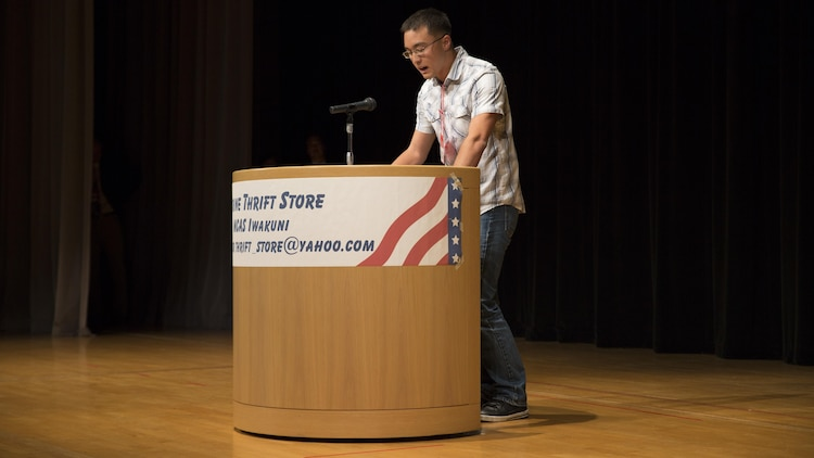"Kevin Barr, a contestant at the 55th Annual Japanese and English Speech Contest, delivers his speech in Japanese at Iwakuni Sinfonia in Iwakuni City, Japan, Nov. 13, 2016. Barr won 3rd place in the advanced Japanese division with his speech ""Heiwa na sekai"". Japanese students delivered speeches in English and Americans in Japanese, while being critiqued on voice control, fluency and overall performance. The speech contest broke through language barriers and cultural differences, creating a stronger relationship between Japanese and Americans.  (U.S, Marine Corps photo by Pfc. Gabriela Garcia-Herrera)"