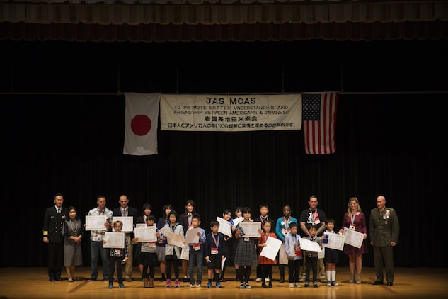 Contestants pose for a picture after receiving their awards at the 55th Annual Japanese and English Speech Contest at Iwakuni Sinfonia in Iwakuni City, Japan, Nov. 13, 2016. The speech contest brought residents and local Japanese together, building stronger bonds while learning a new language and culture. (U.S. Marine Corps photo by Sgt. Carlos Cruz)