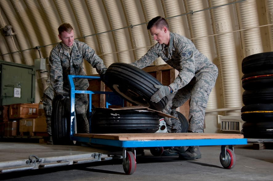 "U.S. Air Force Airman Joshua Fogleman, 51st Logistics Readiness Squadron material management apprentice, and Senior Airman Dustin Murphy, 51st LRS mobility readiness spare package journeyman, load tires onto a cart at the aircraft parts store on Osan Air Base, Republic of Korea, Nov. 16, 2016. The APS is a one-stop shop for maintainers to get the parts needed to keep up ""fight tonight"" readiness. (U.S. Air Force photo by Staff Sgt. Jonathan Steffen)"