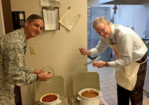 John Sheehan (right), director of customer operations in Subsistence, and Air Force Col. Glenn Chadwick, Industrial Hardware director, judge chili entries for the fifth annual Chili Cook-Off Nov. 15. The cook-off was part of a fundraising event for the 2016 Combined Federal Campaign.