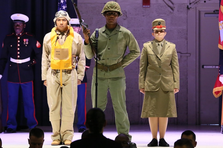 Lance Cpl. Lafayette Halmon (left), Lance Cpl. Adiel Garcia (center) and Lance Cpl. Melissa Dunbal (right), represent Marines in World War II during the annual Historic Uniform Pageant aboard Marine Corps Air Station Cherry Point, N.C., Nov. 4, 2016. The pageant is held to honor the Marine Corps' birthday and features Marines wearing uniforms from all major conflicts the Marine Corps has fought in. The pageant depicts the Corps' long illustrious history throughout decades of warfighting. The pageant also included a traditional cake-cutting ceremony representing the passing of traditions from the eldest Marine to the youngest. (U.S. Marine Corps photo by Lance Cpl. Mackenzie Gibson/Released)