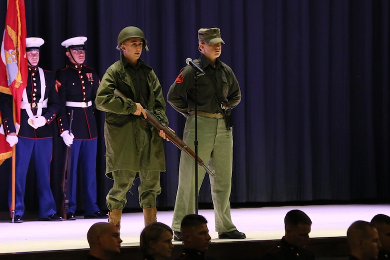 Lance Cpl. Trystan Davila (left) and Pfc. Michelle Smith represent Marines in the Korean War during the annual Historic Uniform Pageant aboard Marine Corps Air Station Cherry Point, N.C., Nov. 4, 2016. The pageant is held to honor the Marine Corps' birthday and features Marines wearing uniforms from all major conflicts the Marine Corps has fought in. The pageant depicts the Corps' long illustrious history throughout decades of warfighting. The pageant also included a traditional cake-cutting ceremony representing the passing of traditions from the eldest Marine to the youngest. (U.S. Marine Corps photo by Lance Cpl. Mackenzie Gibson/Released)