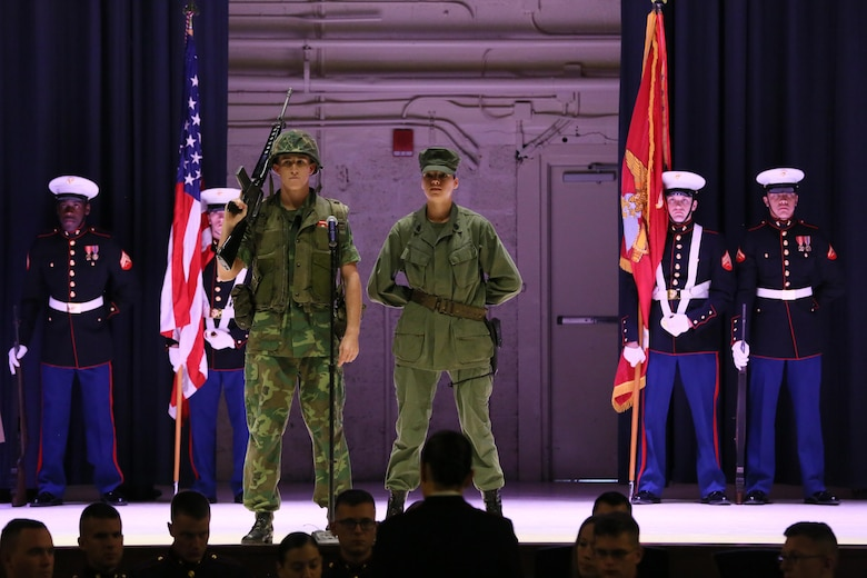 Pfc. Christian Taylor (left) and Pvt. Sierra Robbins represent Marines in the Vietnam War during the annual Historic Uniform Pageant aboard Marine Corps Air Station Cherry Point, N.C., Nov. 4, 2016. The pageant is held to honor the Marine Corps' birthday and features Marines wearing uniforms from all major conflicts the Marine Corps has fought in. The pageant depicts the Corps' long illustrious history throughout decades of warfighting. The pageant also included a traditional cake-cutting ceremony representing the passing of traditions from the eldest Marine to the youngest. (U.S. Marine Corps photo by Lance Cpl. Mackenzie Gibson/Released)