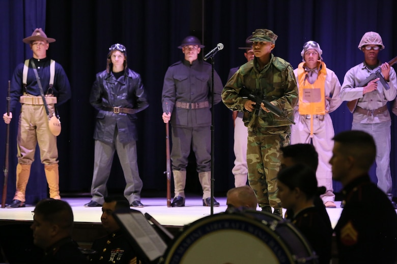 Lance Cpl. Jose Martinez represents a Marine in the 1980's during the annual Historic Uniform Pageant aboard Marine Corps Air Station Cherry Point, N.C., Nov. 4, 2016. The pageant is held to honor the Marine Corps' birthday and features Marines wearing uniforms from all major conflicts the Marine Corps has fought in. The pageant depicts the Corps' long illustrious history throughout decades of warfighting. The pageant also included a traditional cake-cutting ceremony representing the passing of traditions from the eldest Marine to the youngest. (U.S. Marine Corps photo by Lance Cpl. Mackenzie Gibson/Released)