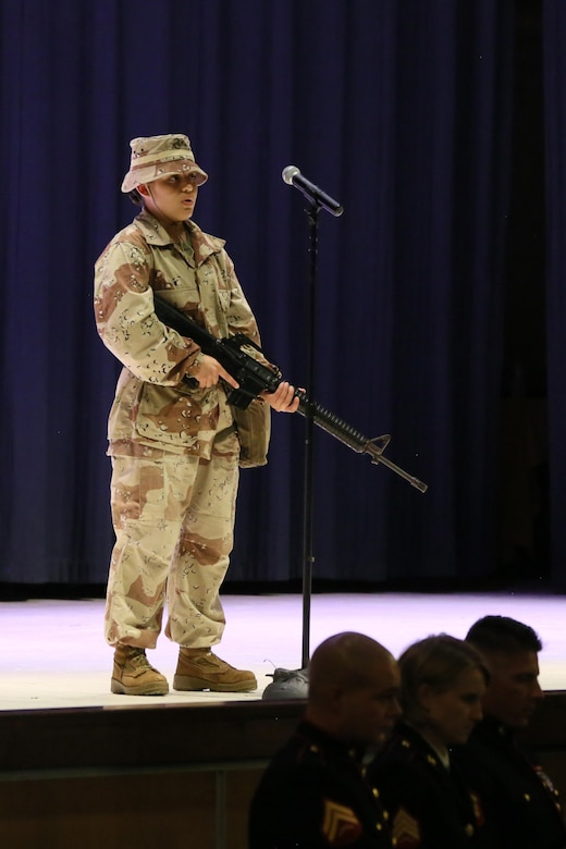 Pvt. Arlette Hernandez represents a Marine in Operations Desert Shield and Desert Storm during the annual Historic Uniform Pageant aboard Marine Corps Air Station Cherry Point, N.C., Nov. 4, 2016. The pageant is held to honor the Marine Corps' birthday and features Marines wearing uniforms from all major conflicts the Marine Corps has fought in. The pageant depicts the Corps' long illustrious history throughout decades of warfighting. The pageant also included a traditional cake-cutting ceremony representing the passing of traditions from the eldest Marine to the youngest. (U.S. Marine Corps photo by Lance Cpl. Mackenzie Gibson/Released)