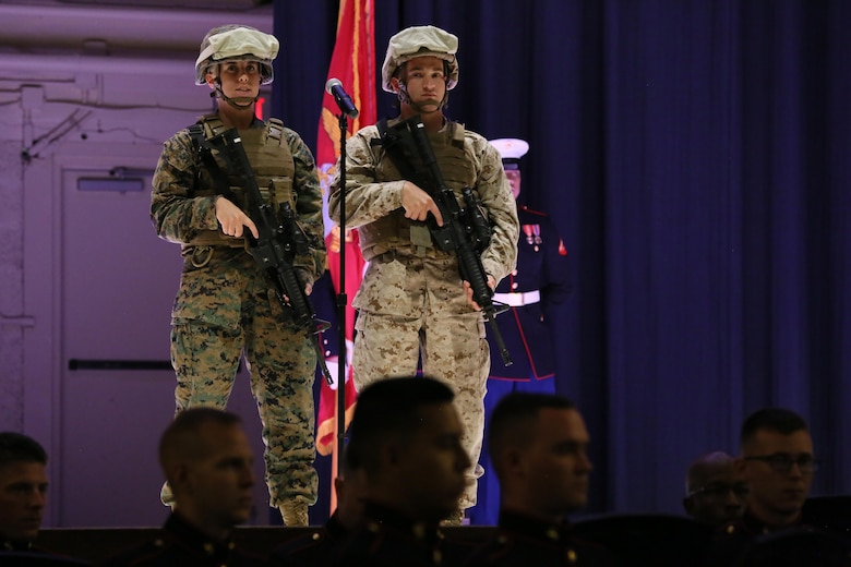 Cpl. Kayla Gilstrap (left) and Lance Cpl. Robert Rocco represent modern day Marines during the annual Historic Uniform Pageant aboard Marine Corps Air Station Cherry Point, N.C., Nov. 4, 2016. The pageant is held to honor the Marine Corps' birthday and features Marines wearing uniforms from all major conflicts the Marine Corps has fought in. The pageant depicts the Corps' long illustrious history throughout decades of warfighting. The pageant also included a traditional cake-cutting ceremony representing the passing of traditions from the eldest Marine to the youngest. (U.S. Marine Corps photo by Lance Cpl. Mackenzie Gibson/Released)