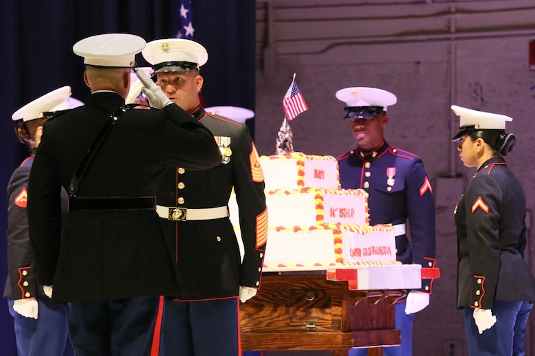 Col. Todd Ferry salutes Sgt. Maj. Benjamin Pangborn during the annual Historic Uniform Pageant aboard Marine Corps Air Station Cherry Point, N.C., Nov. 4, 2016. The pageant is held annually to honor the Marine Corps' birthday, and features Marines wearing uniforms from all major conflicts the Marine Corps has fought in. The pageant also included a traditional cake-cutting ceremony, where the first slice of cake is given to the oldest Marine present and passed to the youngest Marine to symbolize the experience and youthful spirit that are hallmarks of the Marine Corps. Ferry is the commanding officer and Pangborn is the sergeant major for MCAS Cherry Point. (U.S. Marine Corps photo by Lance Cpl. Mackenzie Gibson/Released)