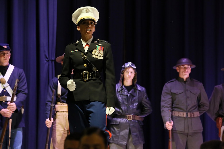 Capt. Deborah Myatt recites John A. Lejeune's birthday message during the annual Historic Uniform Pageant aboard Marine Corps Air Station Cherry Point, N.C., Nov. 4, 2016. The pageant is held to honor the Marine Corps' birthday and features Marines wearing uniforms from all major conflicts the Marine Corps has fought in. The pageant depicts the Corps' long illustrious history throughout decades of warfighting. The pageant also included a traditional cake-cutting ceremony representing the passing of traditions from the eldest Marine to the youngest. Myatt is the MCAS Cherry Point adjutant. (U.S. Marine Corps photo by Lance Cpl. Mackenzie Gibson/Released)