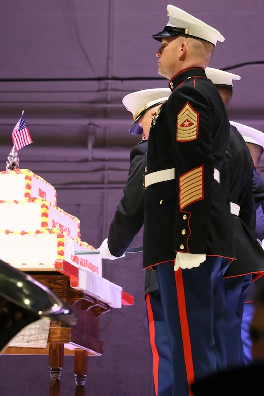 Col. Todd Ferry cuts the birthday cake during the annual Historic Uniform Pageant aboard Marine Corps Air Station Cherry Point, N.C., Nov. 4, 2016. The pageant is held annually to honor the Marine Corps' birthday, and features Marines wearing uniforms from all major conflicts the Marine Corps has fought in. The pageant also included a traditional cake-cutting ceremony, where the first slice of cake is given to the oldest Marine present and passed to the youngest Marine to symbolize the experience and youthful spirit that are hallmarks of the Marine Corps. Ferry is the commanding officer of MCAS Cherry Point. (U.S. Marine Corps photo by Lance Cpl. Mackenzie Gibson/Released)