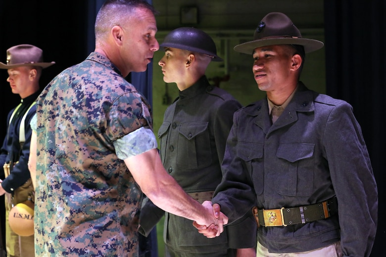 Brig. Gen. Matthew Glavy shakes hands with a Marine participating in the annual Historic Uniform Pageant aboard Marine Corps Air Station Cherry Point, N.C., Nov. 4, 2016. The pageant is held to honor the Marine Corps' birthday and features Marines wearing uniforms from all major conflicts the Marine Corps has fought in. The pageant depicts the Corps' long illustrious history throughout decades of warfighting. The pageant also included a traditional cake-cutting ceremony representing the passing of traditions from the eldest Marine to the youngest. Glavy is the 2nd Marine Aircraft Wing commanding general. (U.S. Marine Corps photo by Lance Cpl. Mackenzie Gibson/Released)