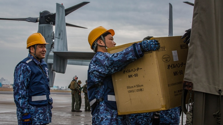 Japan Maritime Self-Defense Force members carry simulated humanitarian supplies from a MV-22B Osprey tiltrotor aircraft from Marine Medium Tiltrotor Squadron 262, 31st Marine Expeditionary Unit ,at Oruma Air Base, Nagasaki, Japan, Nov. 18, 2016. The aircraft flew from the island of Okinawa, conducted simulated humanitarian aid with the JMSDF at multiple locations and was refueled by JMSDF personnel before returning to Okinawa. The aircraft also conducted a passenger exercise carrying Sasebo Mayor Norio Tomonaga and the Assemblymen of Defense for Sasebo City.