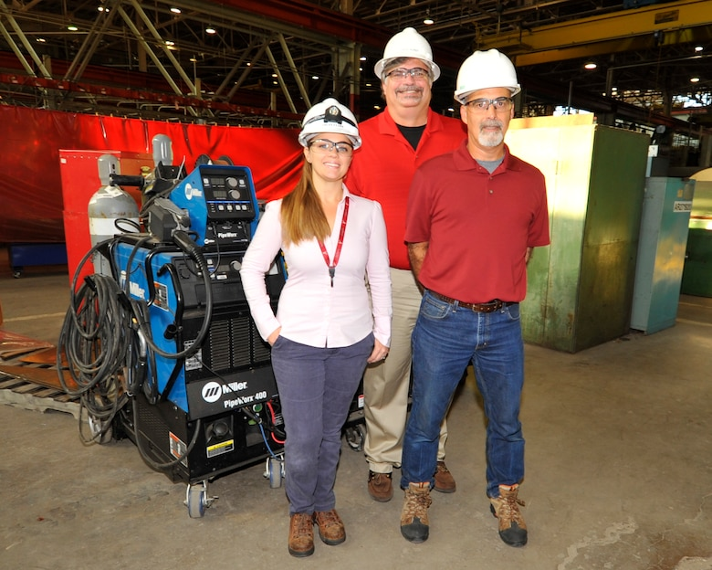 David Hurst, Asset Health Assurance Group Manager for the AEDC Model and Machine Shop, recently recognized Ashley Clark, left, and Tracy McDonald, for their efforts in reducing the cost of the preventative maintenance program for welding machines. Their work will lead to a savings over the life of the contract of approximately $200,000.