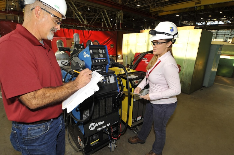 AEDC engineers Ashley Clark, right, and Tracy McDonald, check the performance of a welding machine at the Model and Machine Shop as part of the preventative maintenance program for the machines. Clark and McDonald worked to reduce the cost of the preventative maintenance program by developing a pre-operations checklist for each welding machine which moved a lot of the preventive maintenance program from a calendar driven program to a condition-based maintenance approach. This change is anticipated to yield a major cost savings for AEDC. (U.S. Air Force program/Rick Goodfriend)