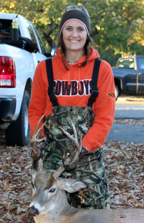 Jennifer Shultz with the buck she bagged during the disabled sportsman hunt at Oologah Lake. The annual hunt is sponsored by the Oklahoma Department of Wildlife Conservation.