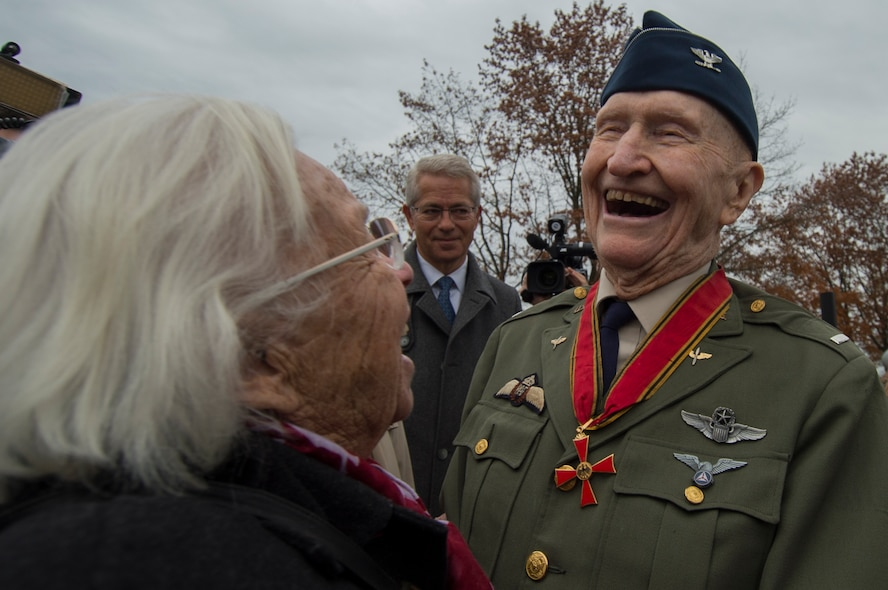 Retired U.S. Air Force Col. Gail Halvorsen, a C-52 Skymaster pilot also known as the Candy Bomber, visits with Gisela Rainare, a former civilian employee at the former Frankfurt an Main Air Base, Germany,  before the reopening ceremony of the Berlin Airlift Memorial outside Frankfurt International Airport, Germany, Nov. 22, 2016. Both Halvorsen and Rainare worked as part of the Berlin Airlift, also known as Operation Vittles, which delivered more than two million tons of food to the blockaded citizens of West Berlin between June 1948 and September 1949. (U.S. Air Force photo by Staff Sgt. Joe W. McFadden)