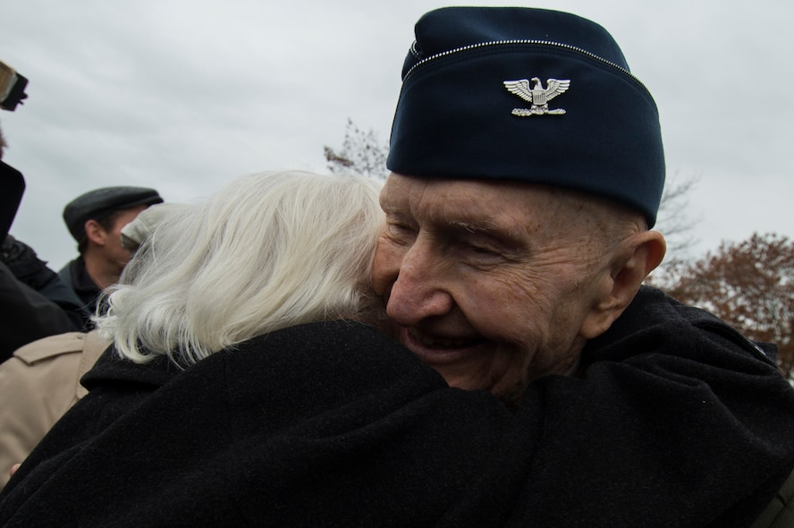 Retired U.S. Air Force Col. Gail Halvorsen, a C-52 Skymaster pilot also known as the Candy Bomber, hugs Gisela Rainare, a former civilian employee at the former Frankfurt an Main Air Base, Germany,  before the reopening ceremony of the Berlin Airlift Memorial outside Frankfurt International Airport, Germany, Nov. 22, 2016. Both Halvorsen and Rainare worked as part of the Berlin Airlift, also known as Operation Vittles, which delivered more than two million tons of food to the blockaded citizens of West Berlin between June 1948 and September 1949. (U.S. Air Force photo by Staff Sgt. Joe W. McFadden)