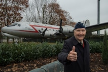 Retired U.S. Air Force Col. Gail Halvorsen, a C-52 Skymaster pilot also known as the Candy Bomber, gives a thumbs up gesture after the reopening ceremony of the Berlin Airlift Memorial outside Frankfurt International Airport, Germany, Nov. 22, 2016. Halvorsen and his fellow pilots dropped 23 tons of candy with makeshift parachutes from his C-54 as part of the Berlin Airlift, which delivered more than two million tons of food to the blockaded citizens of West Berlin between June 1948 and September 1949. (U.S. Air Force photo by Staff Sgt. Joe W. McFadden)