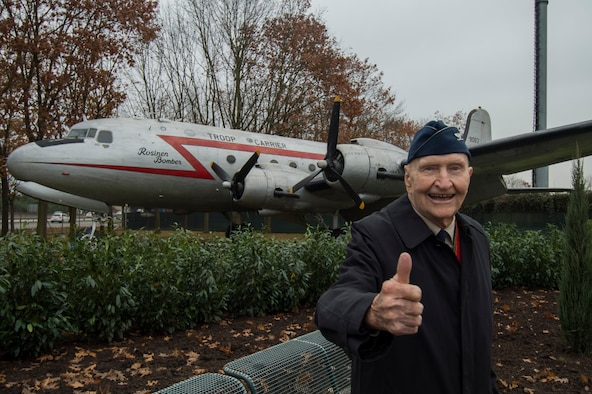 "Retired Col. Gail Halvorsen, a C-52 Skymaster pilot also known as the ""Berlin Candy Bomber,"" gives a thumbs-up gesture after the reopening ceremony of the Berlin Airlift Memorial outside Frankfurt International Airport, Germany, Nov. 22, 2016. Halvorsen and his fellow pilots dropped 23 tons of candy with makeshift parachutes from his C-54 as part of the Berlin Airlift, which delivered more than 2 million tons of food to the blockaded citizens of West Berlin between June 1948 and September 1949. (U.S. Air Force photo/Staff Sgt. Joe W. McFadden)"