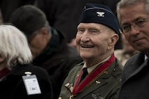 Retired U.S. Air Force Col. Gail Halvorsen, a C-52 Skymaster pilot also known as the Candy Bomber, smiles before the reopening ceremony of the Berlin Airlift Memorial outside Frankfurt International Airport, Germany, Nov. 22, 2016. Halvorsen and his fellow pilots dropped 23 tons of candy with makeshift parachutes from his C-54 as part of the Berlin Airlift, which delivered more than two million tons of food to the blockaded citizens of West Berlin between June 1948 and September 1949. (U.S. Air Force photo by Staff Sgt. Joe W. McFadden)