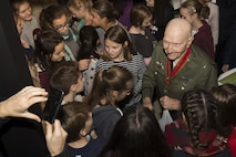 Retired U.S. Air Force Col. Gail Halvorsen, a C-52 Skymaster pilot also known as the Candy Bomber, hands out chocolate bars to German children after the reopening ceremony of the Berlin Airlift Memorial outside Frankfurt International Airport, Germany, Nov. 22, 2016. Halvorsen and his fellow pilots dropped 23 tons of candy with makeshift parachutes from his C-54 as part of the Berlin Airlift, which delivered more than two million tons of food to the blockaded citizens of West Berlin between June 1948 and September 1949. (U.S. Air Force photo by Staff Sgt. Joe W. McFadden)