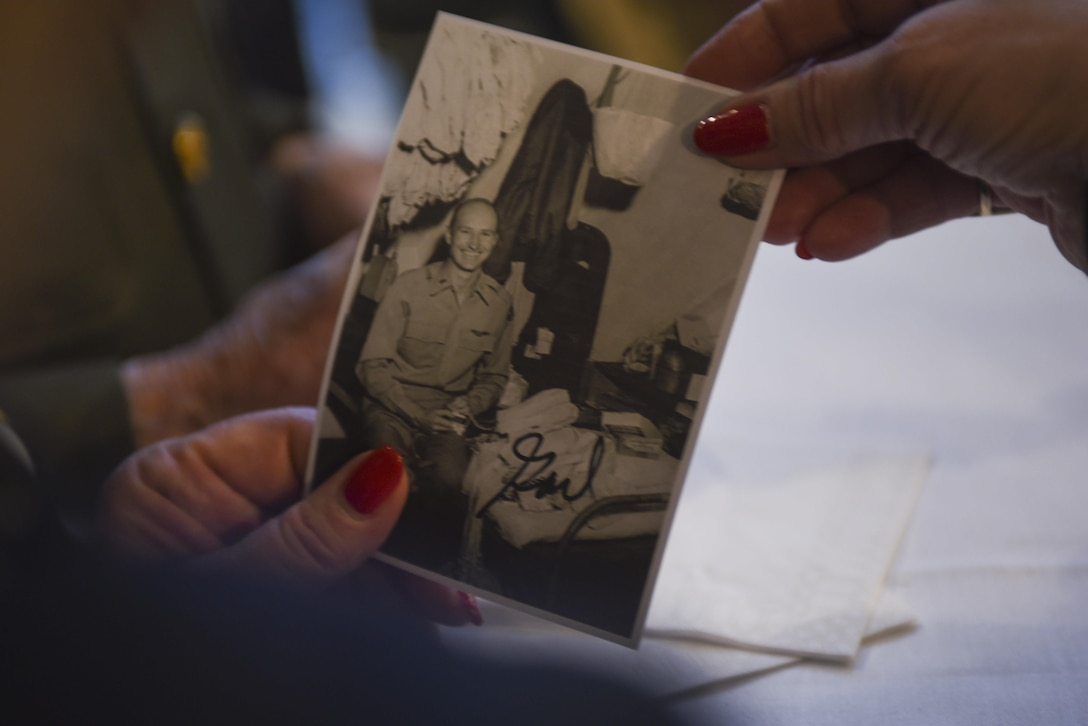 A German woman holds up a signed replica photo of then-U.S. Air Force 1st Lt. Gail Halvorsen, a C-52 Skymaster pilot also known as the Candy Bomber, after the reopening ceremony of the Berlin Airlift Memorial outside Frankfurt International Airport, Germany, Nov. 22, 2016. Halvorsen and his fellow pilots dropped 23 tons of candy with makeshift parachutes from his C-54 as part of the Berlin Airlift, which delivered more than two million tons of food to the blockaded citizens of West Berlin between June 1948 and September 1949. (U.S. Air Force photo by Staff Sgt. Joe W. McFadden)