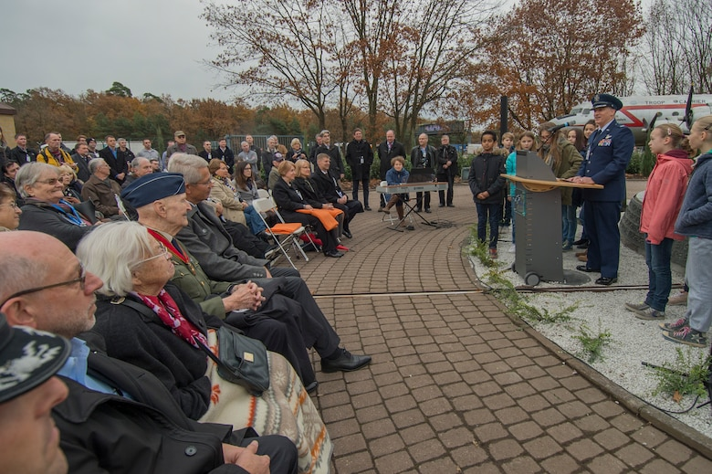 U.S. Air Force Col. Timothy Stretch, U.S. Air Forces Europe representative on behalf of the commander, speaking during the reopening ceremony of the Berlin Airlift Memorial outside Frankfurt International Airport, Germany, Nov. 22, 2016. The ceremony included retired U.S. Air Force Col. Gail Halvorsen, also known as the Candy Bomber, who dropped 23 tons of candy with makeshift parachutes from his C-54 Skymaster as part of the humanitarian supply mission. The Berlin Airlift, also known as Operation Vittles, delivered more than two million tons of food to the blockaded citizens of West Berlin between June 1948 and October 1949. (U.S. Air Force photo by Staff Sgt. Joe W. McFadden)