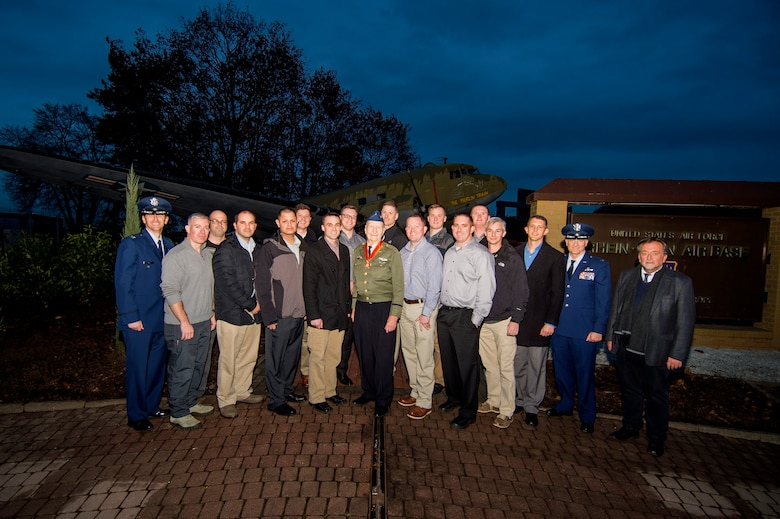 Retired U.S. Air Force Col. Gail Halvorsen, a C-52 Skymaster pilot also known as the Candy Bomber, center, poses with U.S. Air Forces in Europe Airmen from Spangdahlem Air Base, Germany, and Ramstein Air Base, Germany, after the reopening ceremony of the Berlin Airlift Memorial outside Frankfurt International Airport, Germany, Nov. 22, 2016. Most of the Airmen serve with the 726th Air Mobility Squadron, which traces its lineage to Halvorsen's efforts as part of the airlift, which delivered more than two million tons of food to the blockaded citizens of West Berlin between June 1948 and October 1949. (U.S. Air Force photo by Staff Sgt. Joe W. McFadden)