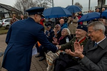 U.S. Air Force Col. Timothy Stretch, U.S. Air Forces Europe representative on behalf of the commander, shakes the hand of retired U.S. Air Force Col. Gail Halvorsen, also known as the Candy Bomber, during the reopening ceremony of the Berlin Airlift Memorial outside Frankfurt International Airport, Germany, Nov. 22, 2016. Halvorsen and his fellow Airmen dropped 23 tons of candy with makeshift parachutes from his C-54 Skymaster as part of the humanitarian supply mission, which delivered more than two million tons of food to the blockaded citizens of West Berlin between June 1948 and October 1949. (U.S. Air Force photo by Staff Sgt. Joe W. McFadden)