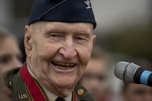 Retired U.S. Air Force Col. Gail Halvorsen, a C-52 Skymaster pilot also known as the Candy Bomber, speaks during a reopening ceremony of the Berlin Airlift Memorial outside Frankfurt International Airport, Germany, Nov. 22, 2016. Halvorsen and his fellow pilots dropped 23 tons of candy with makeshift parachutes from his C-54 as part of the Berlin Airlift, which delivered more than two million tons of food to the blockaded citizens of West Berlin between June 1948 and October 1949. (U.S. Air Force photo by Staff Sgt. Joe W. McFadden)