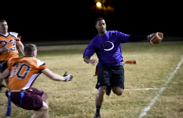 The Defense Media Activity quarterback runs for positive yards during the Division Two Flag Football Championship game against the 7th Intelligence Squadron, November 17, 2016 at Fort George G. Meade, Md. The 7th IS beat DMA 16-6 in Game One to force a Game Two. They won Game Two by a score of 20-14. (U.S. Air Force photo/Staff Sgt. AJ Hyatt)