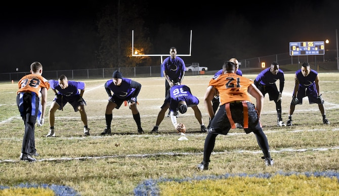 The Defense Media Activity offense gets set near the goal line during the Division Two Flag Football Championship game against the 7th Intelligence Squadron, November 17, 2016 at Fort George G. Meade, Md. The 7th IS beat DMA 16-6 in Game One to force a Game Two. They won Game Two by a score of 20-14. (U.S. Air Force photo/Staff Sgt. AJ Hyatt)
